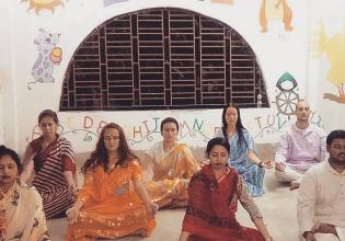 Yoga and meditation workshop while teaching community children